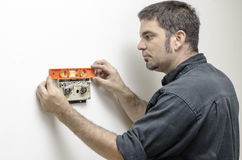 Technician Leveling Thermostat Royalty Free Stock Photos