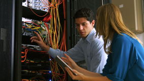 Technician looking at open server locker. In high quality format stock footage