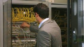 Technician looking at open server locker stock footage