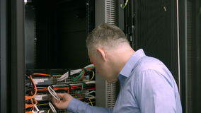 Technician looking at open server locker stock video