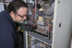 Free Technician Looking Over A Gas Furnace Royalty Free Stock Photo - 60260925