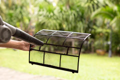 Technician man dry up and dust cleaning air Conditioner filter w Royalty Free Stock Photography