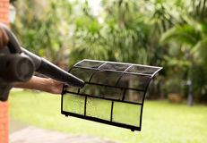 Technician man dry up and dust cleaning air Conditioner filter w Stock Photo