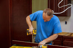 technician man installing kitchen cabinets Royalty Free Stock Photo
