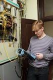 Technician measuring fiber optic. The technician measuring fiber optic link at a server room Stock Photo
