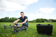 Technician With Octocopter Drone in Park stock image