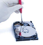 Technician with open hard-disk Stock Images