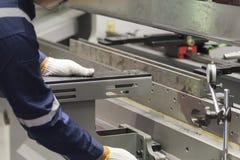 The technician operator use hydraulic bending machine. Royalty Free Stock Photos