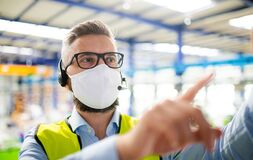 Free Technician Or Engineer With Protective Mask Working In Industrial Factory. Stock Image - 184303391
