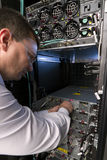 Technician perform maintenance to a server Stock Photos