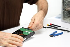 Technician person is repairing a computer. On a desk Royalty Free Stock Image