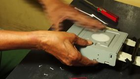Technician placing back the Top Cover Casing of DVD Optical Drive. Close up stock video footage