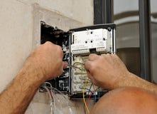 Technician placing the new intercom phone Stock Photos