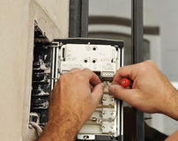 Free Technician Placing The New Intercom Phone Stock Images - 84051494