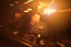 Technician plug in CPU microprocessor  to motherboard Royalty Free Stock Photos