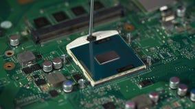 Technician plug in CPU microprocessor to motherboard socket. stock footage