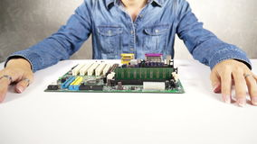 Technician plugging a RAM into the computer motherboard stock video