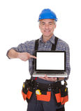 Technician Pointing On Laptop Stock Image