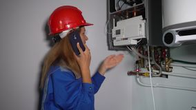 Technician polite woman talking with her boss or client on phone stock video