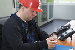 Technician prepare to make phone call in the power plant contr royalty free stock photo