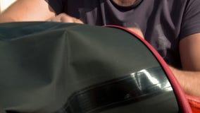 Technician prepares hot air balloon for flight stock footage