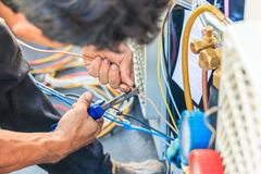 An air condition technician. A technician is preparing to install the new air condition stock photography