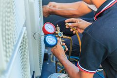 An air condition technician. A technician is preparing to install the new air condition royalty free stock images