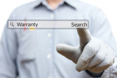 Technician pressing warranty word in search bar Royalty Free Stock Photo