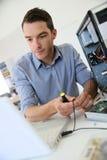 Technician proceeding to data recovery Stock Photos