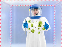 Technician in protective suit holding biological sample Stock Photography