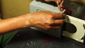 Technician pull out the front cover of the dvd drive tray. Close up stock footage