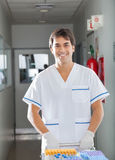 Technician Pushing Medical Cart In Hospital royalty free stock image