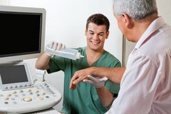 Technician Putting Gel On Patient's Hand Stock Photos