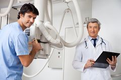 Technician And Radiologist At Clinic Stock Photo