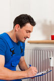 Technician reading the heat meter. To check consumption Royalty Free Stock Image