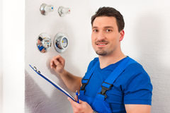 Technician reading the water meter Stock Image