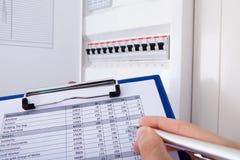 Technician Recording Machine Temperature Stock Photos