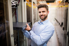 Technician removing server from rack mounted server Stock Image