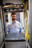 Technician removing server from rack mounted server stock photos