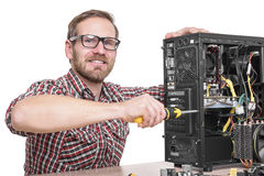 Technician repair assembles computer. Isolated on a white background Stock Photography