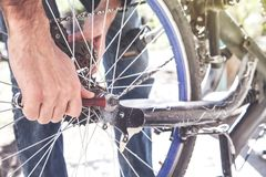 Technician are repairing bicycle with spanner. stock photography