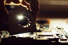 Technician repairing a broken computer Royalty Free Stock Photography