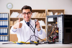 The it technician repairing broken pc desktop computer. IT technician repairing broken pc desktop computer Stock Photography