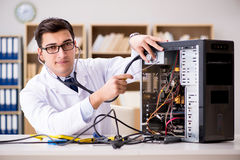 The it technician repairing broken pc desktop computer. IT technician repairing broken pc desktop computer Stock Photo