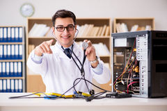 The it technician repairing broken pc desktop computer. IT technician repairing broken pc desktop computer Stock Photos