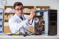 The it technician repairing broken pc desktop computer. IT technician repairing broken pc desktop computer Royalty Free Stock Photos