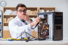 The it technician repairing broken pc desktop computer. IT technician repairing broken pc desktop computer Stock Images