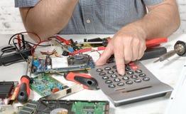 Technician repairing a computer. A technician repairing a computer Stock Image
