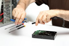 Technician is repairing. A computer on a desk Royalty Free Stock Images
