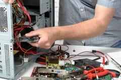 A technician repairing a computer Stock Photo